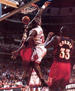 Michael Jordan dunk over Dikembe Mutombo